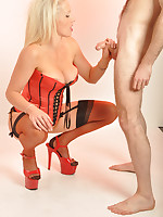 Rebecca More sucks cock in her gorgeous red corset and matching stiletto heels