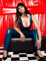 Desyra Noir posing in blue latex swimsuit