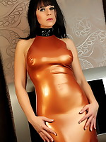 Sexy MILF Desyra Noir wrapped in a bronze dress