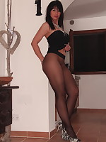 Sexy babe is topless and wrapped in black pantyhose