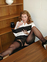 Secretary flashing her black panties and stockings